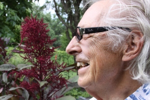 Budd Gauger with an amaranth blossom, always a favorite in his garden, as seen in August 2009.